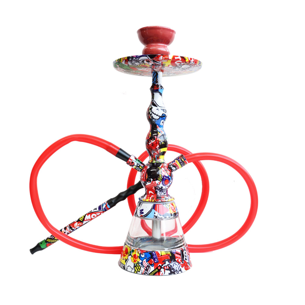 A decorated shisha pipe with one hose on a wooden table in a Christmas themed background